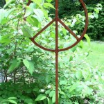 Square bar garden peace sign sculpture.