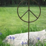 Oversized garden peace sign aculpture.