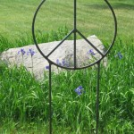 Large garden peace sign sculpture.