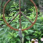 Garden peace sign with patinated moon and bead.
