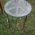 Handmade steel peace sign end table.