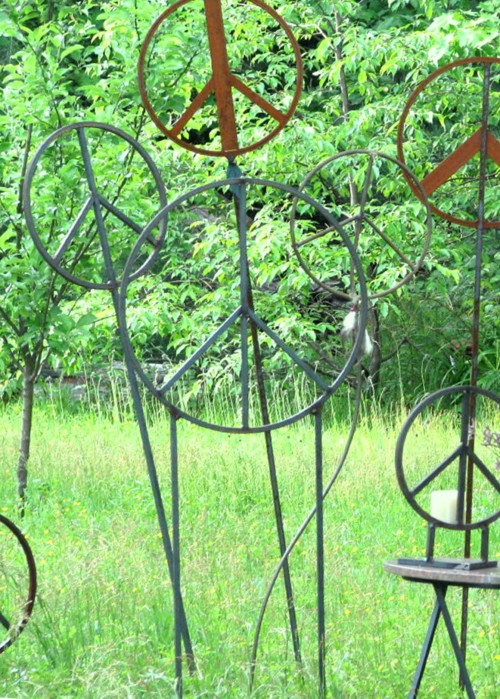 Group of steel garden peace signs.