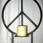 Table top peace sign candle holder.
